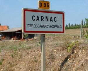 Panneau du village de Carnac-Rouffiac dans le Lot